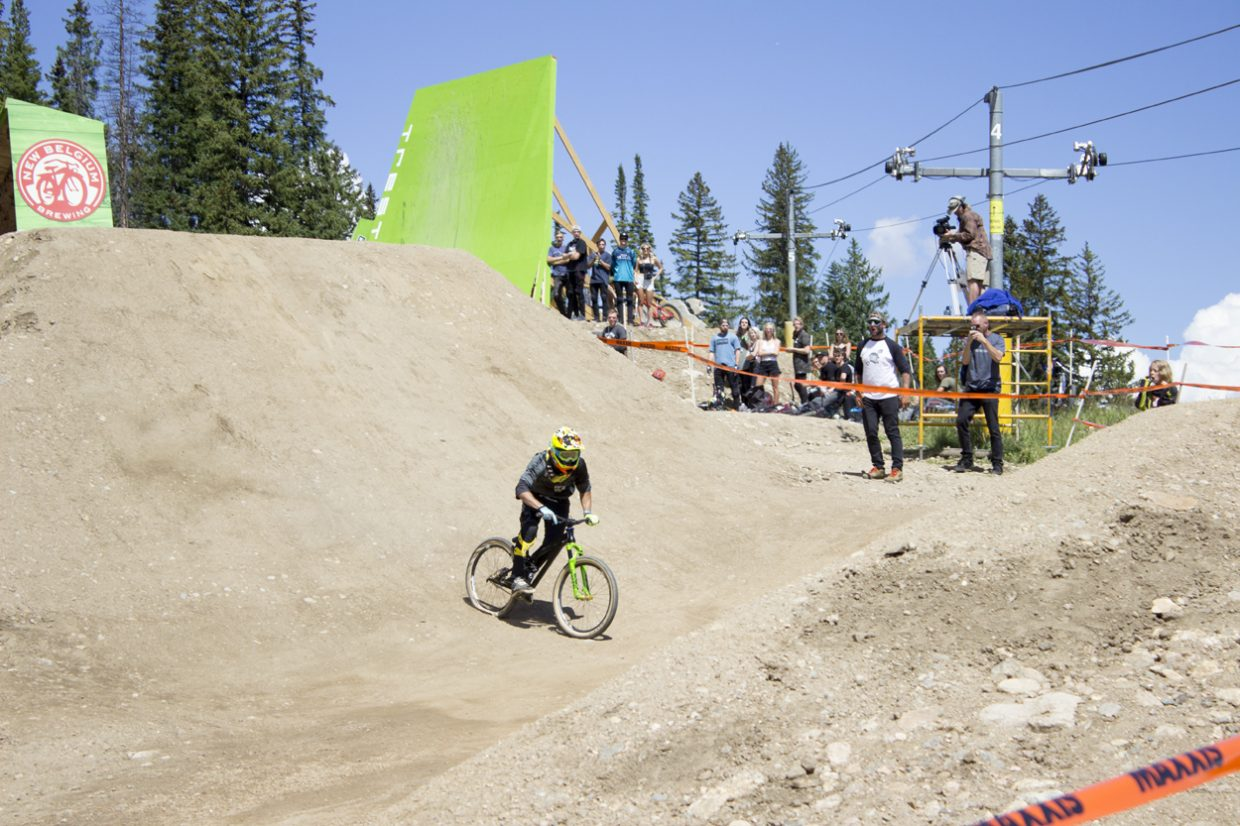 A rider blows out his back tire landing on the second jump of the course. Sawyer D'Argonne / Sky-Hi News.