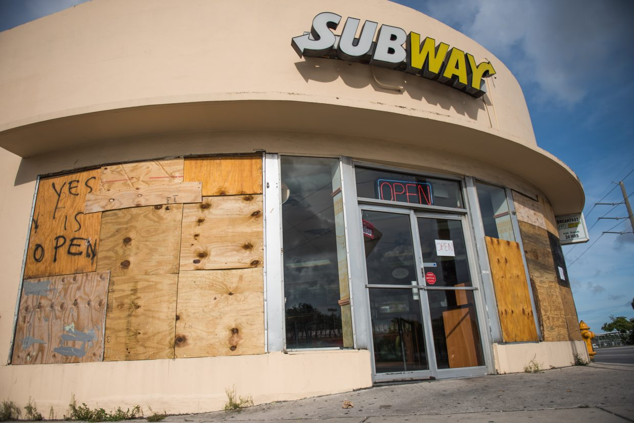 A Miami Subway boards up its windows in preparation of Hurricane Irma. (Photo by Tyler Tomasello)