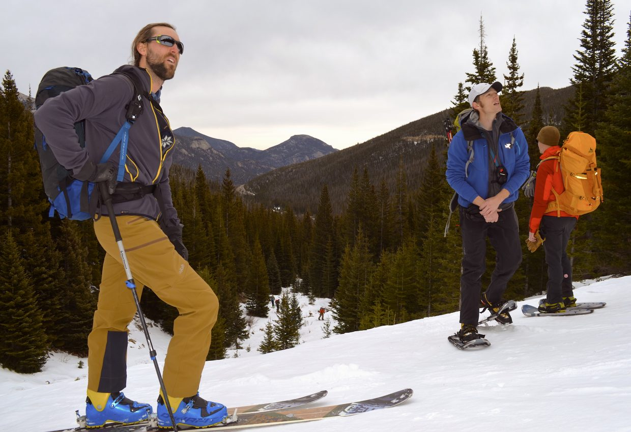 AIARE Level 1 Course instructor Ben Markhart (left) and course students Aaron Oakley (center) and Nate Landry (right) pause for a quick break on their way up to Trail Ridge Road through the erstwhile ski resort, Hidden Valley, located in Rocky Mountain National Park.