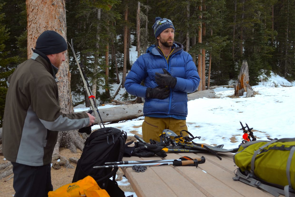 Course instructor Ben Markhart conducts a quick pre-trip briefing, reviewing avalanche forecasts, weather conditions and travel plans he and his students head up into Hidden Valley.