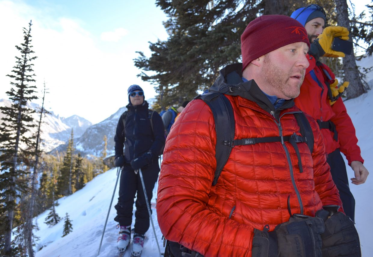 AIARE student Jeff Harris (foreground) and other Colorado Mountain School students listen intently as lead instructor Joey Thompson (out of shot) conducts an impromptu snow stability test.