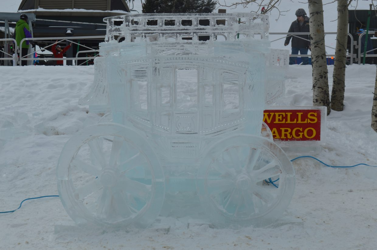 Thomas Barlow sculpts a stagecoach out of ice, his fourth time creating a sculpture for the event. Here is a look at the finished product.