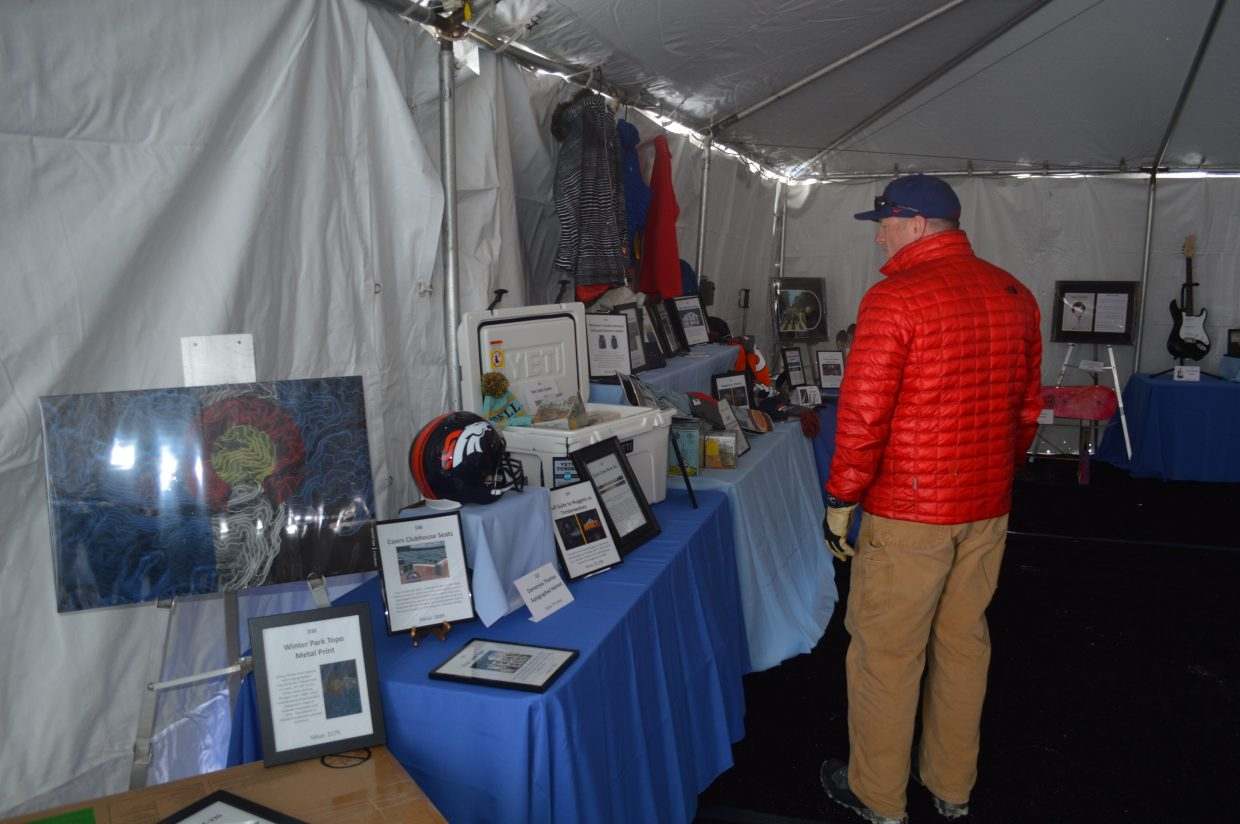 The event also includes a silent auction to benefit the NSCD. Items included a signed Eric Clapton guitar, skis, signed broncos memorabilia and tons more.