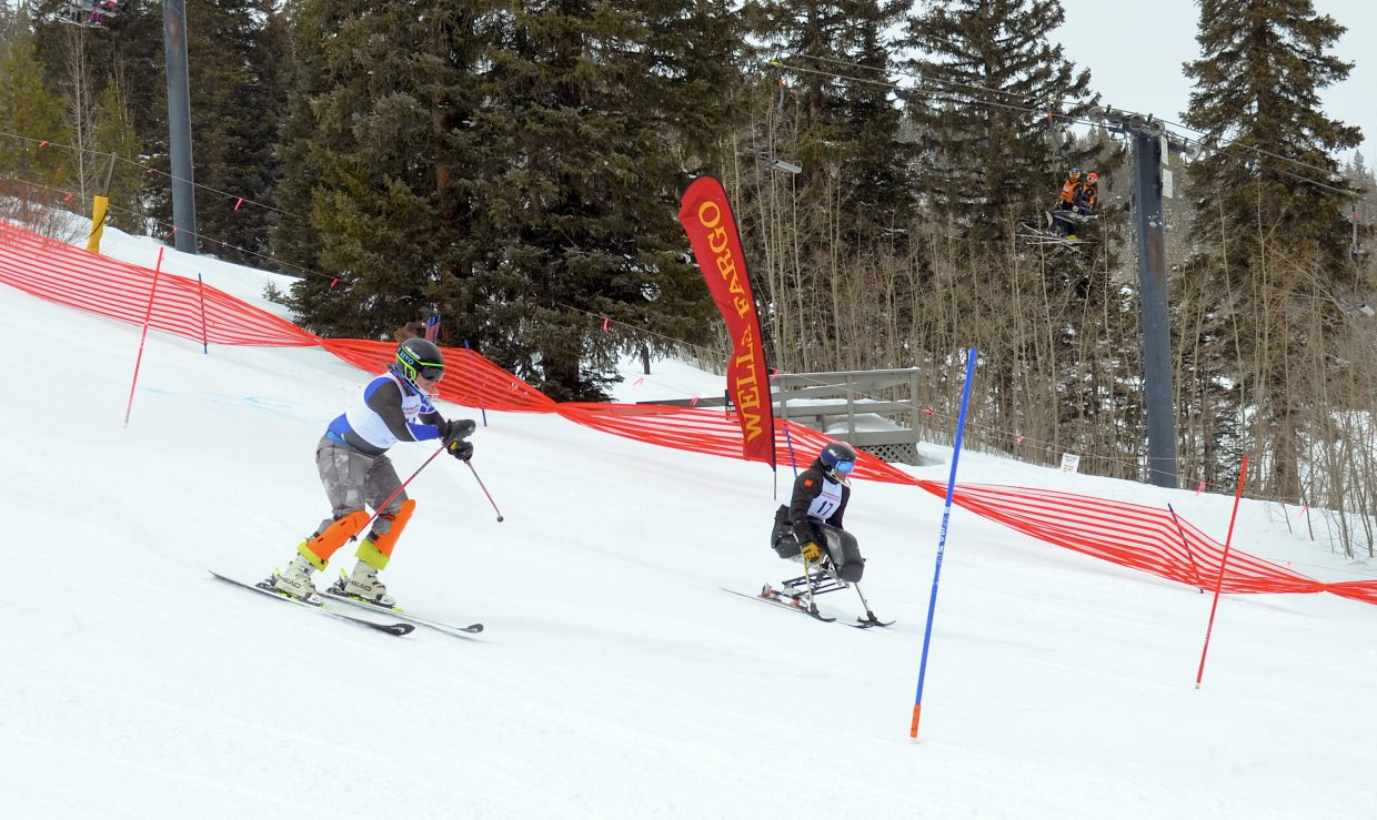A pair of skiers race for the finish line during finals competition of the World Disabled Invitational finals Sunday.