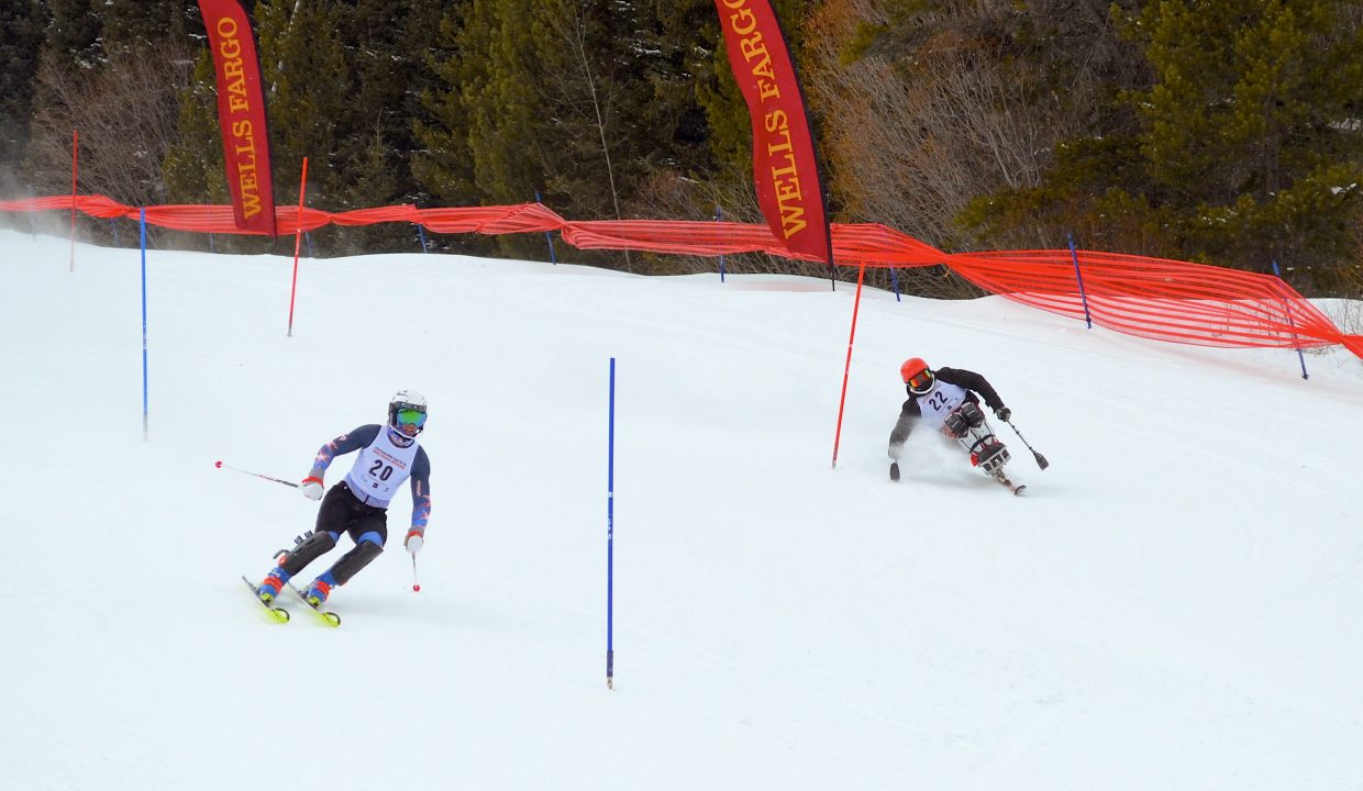 Two skiers race down the course during the Word Disabled Invitational finals Sunday afternoon.