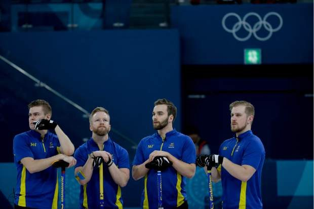 Sweden's team look on during the men's final curling match against United States at the 2018 Winter Olympics in Gangneung, South Korea, Saturday, Feb. 24, 2018. (AP Photo/Natacha Pisarenko)