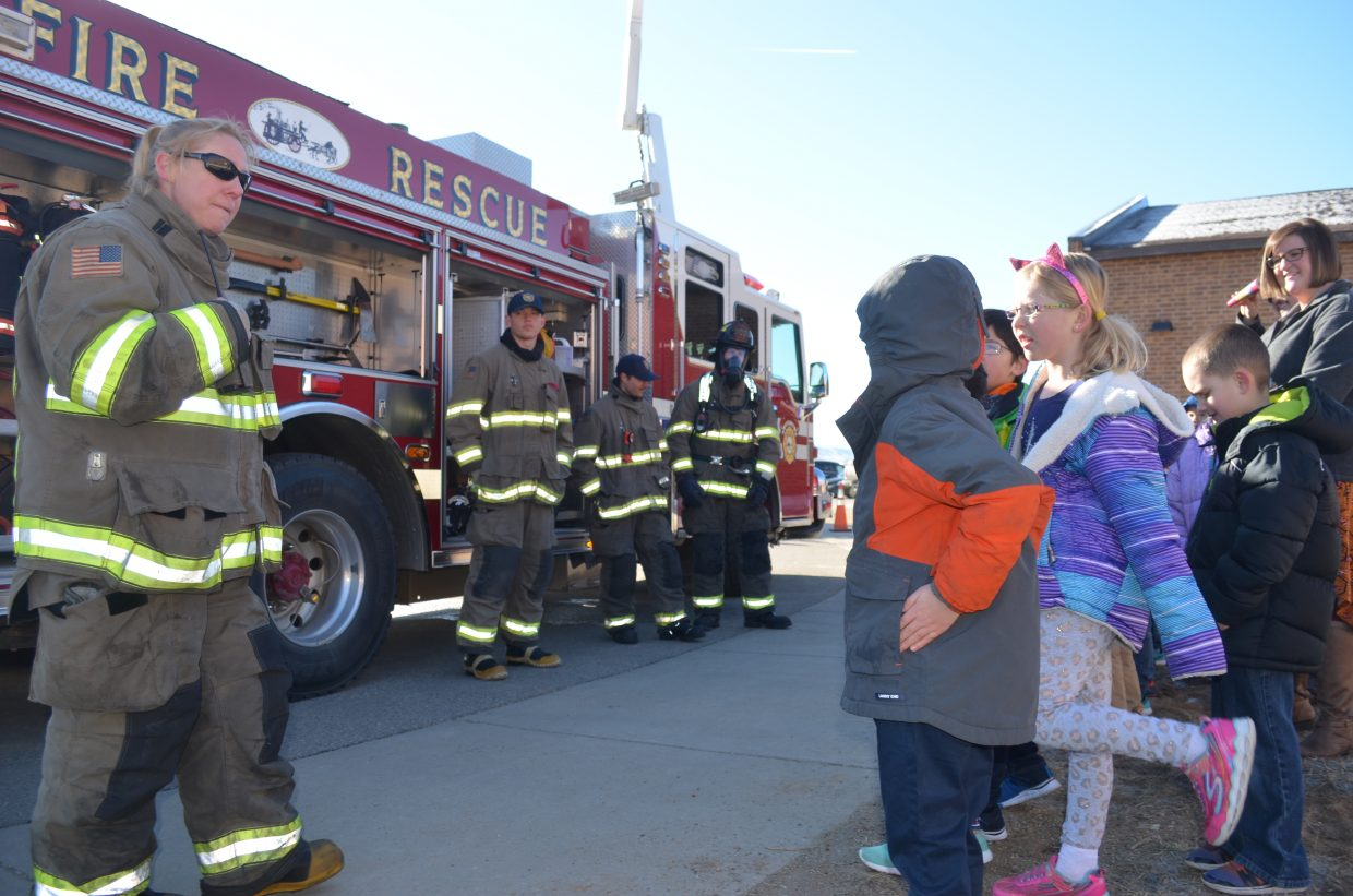 Representatives from the Grand Fire Protection District explain how they do their jobs to Granby Elementary students Tuesday morning.
