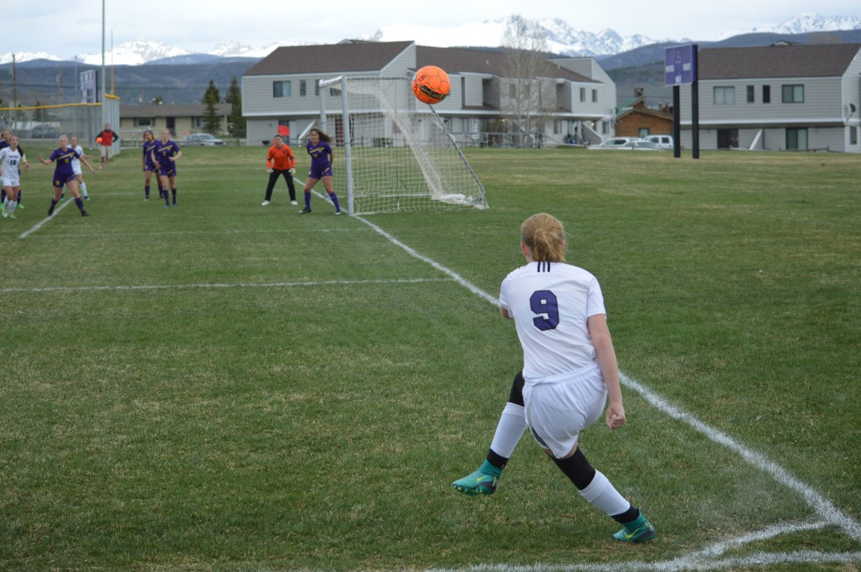 Junior Ellie Mackendrick takes a corner kick.