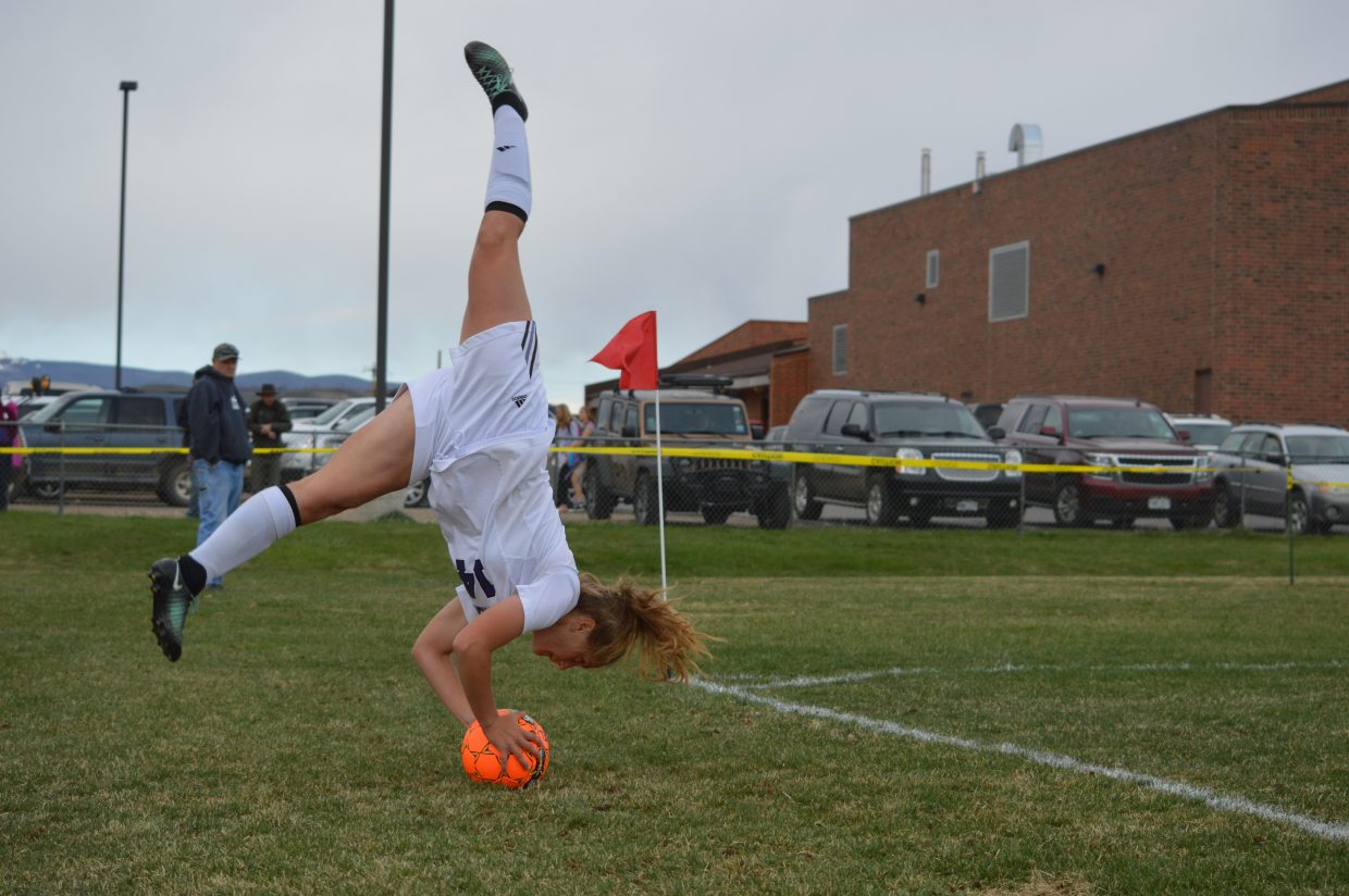Junior Taylor Ehlert flips and hurls the throw-in.