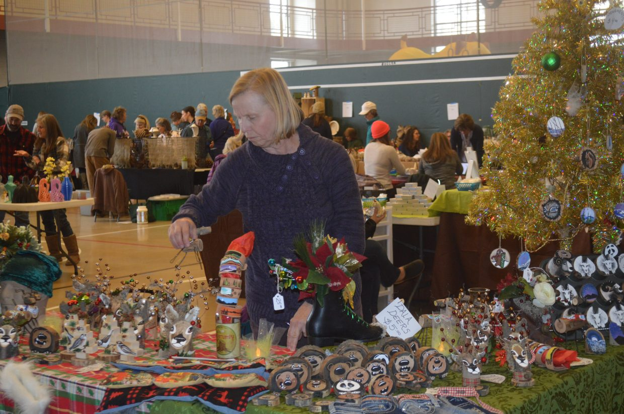 Wendy Carmichael, from Granby, sold wooden holiday decorations at her booth. She said she decided to participate in the craft fair for the first time this year because she has so much fun creating her pieces.