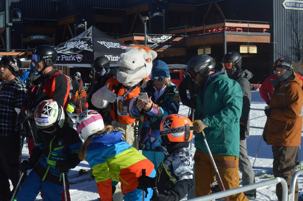 Broncos' mascot Miles entertains the skiers and riders in line at the Arrow lift.