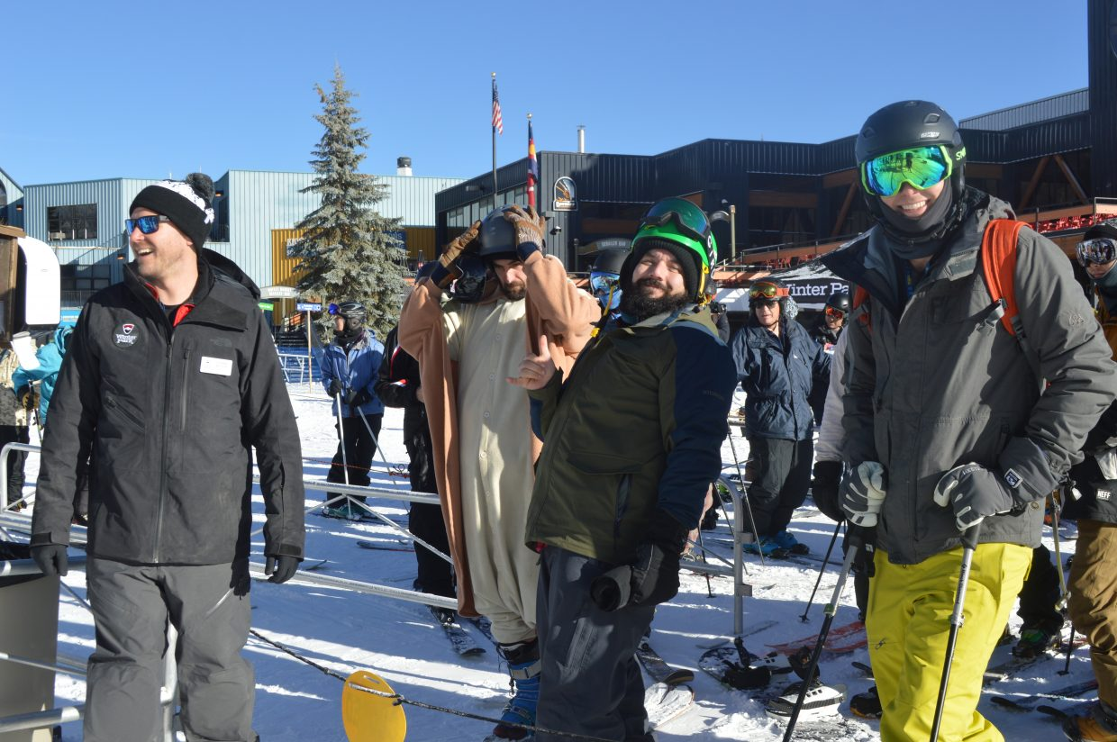 Carlos Galindo, a local resident who camped out overnight to get first chair, waits in line at the Arrow lift.