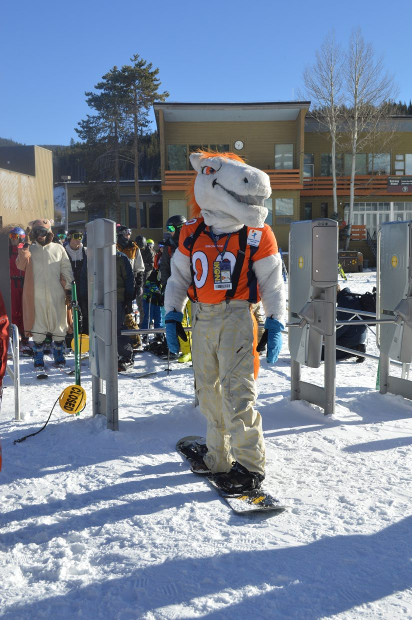 Broncos' mascot Miles prepares to take the first chair at the Arrow lift.