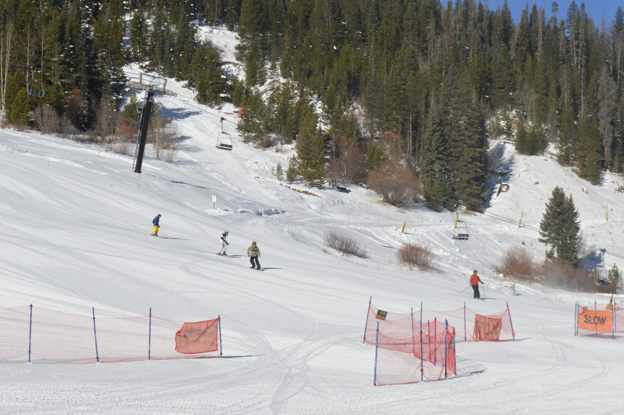 Some of the first skiers and riders coming down Larry Sale and Village Way.