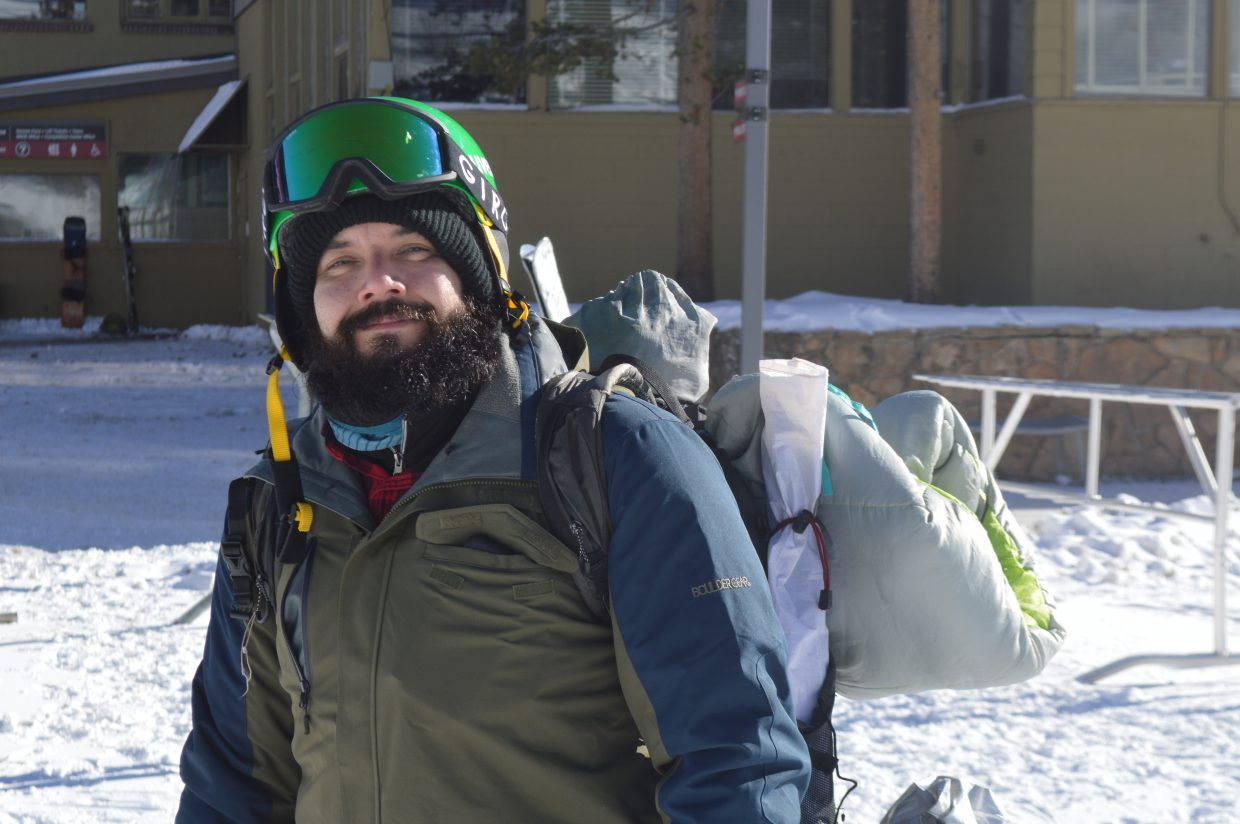 Galindo with his overnight camping gear after getting to take the first chair up the mountain.