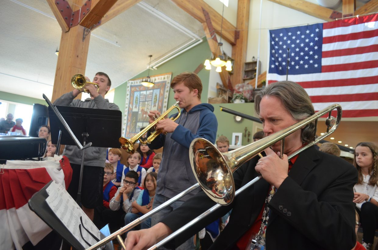 Middle Park High School Music Director Brad Pregeant (right) performs with several of his top students at the beginning of Grand County's Veterans Day activities.