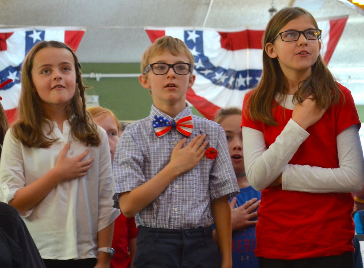 Local school kids, who sang for Grand County's veterans Monday morning, recite the Pledge of Allegiance.