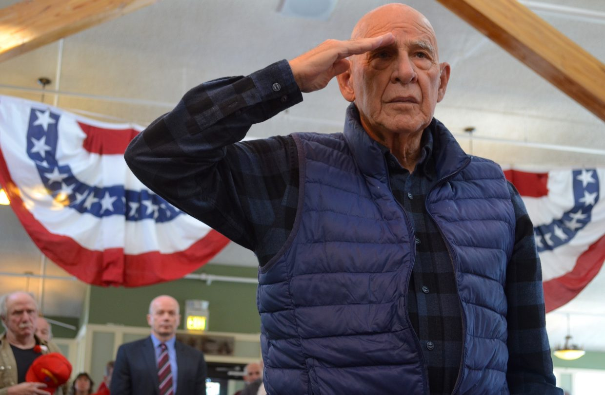 Rudy Perez salutes the flag during ceremonial proceedings Monday morning at Snow Mountain Ranch.