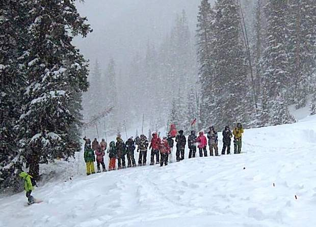 A probe lines works through a section of Berthoud Pass while searching for the body of Jeff Miller in January 2011. This photo was taken mere minutes before searchers located Miller's body.