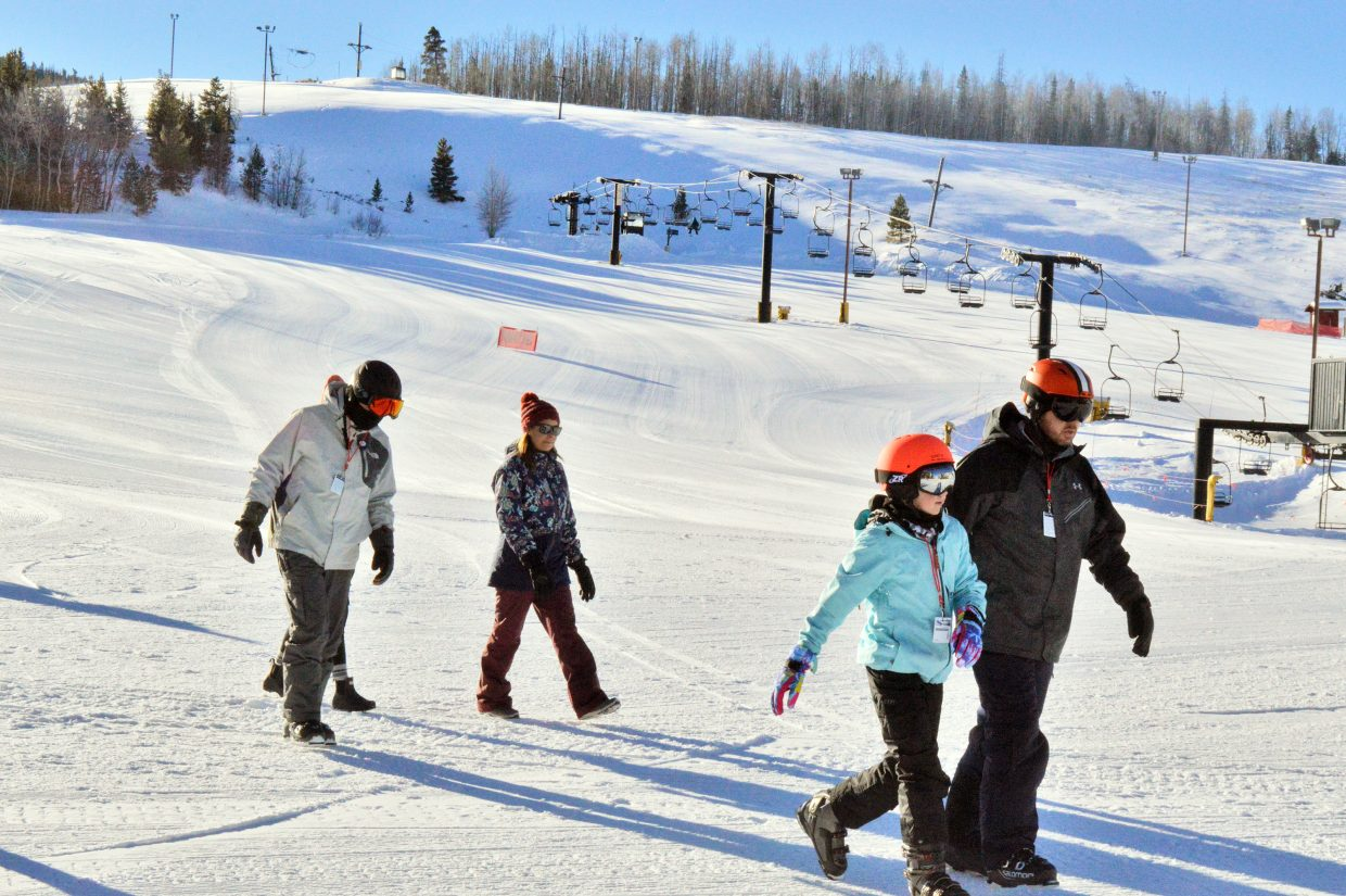 Walking across the groomed terrain Friday at Ski Granby Ranch.