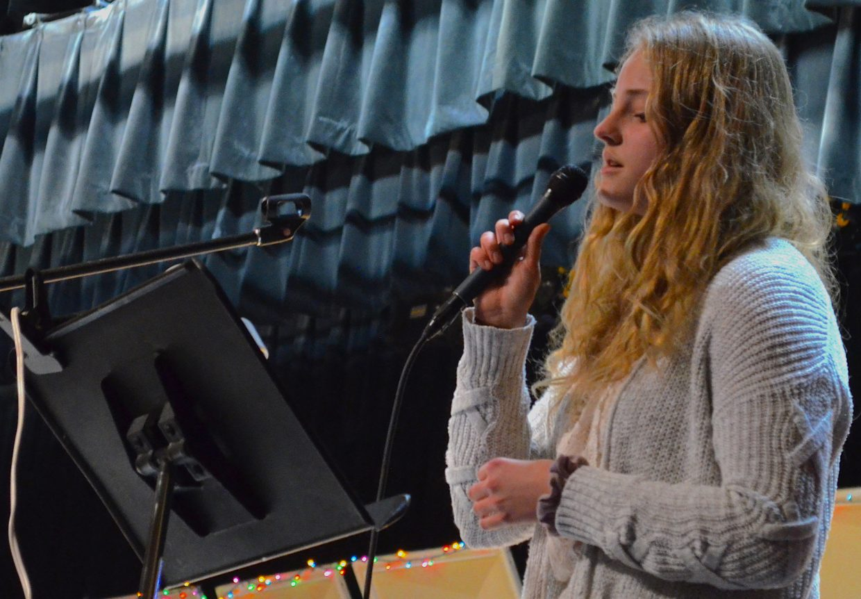 """Middle Park High School student Katelyn Cimino performs as a special guest singer for the song """"Christmas Time in the Rockies"""" during the Holiday Band Concert Wednesday night."""
