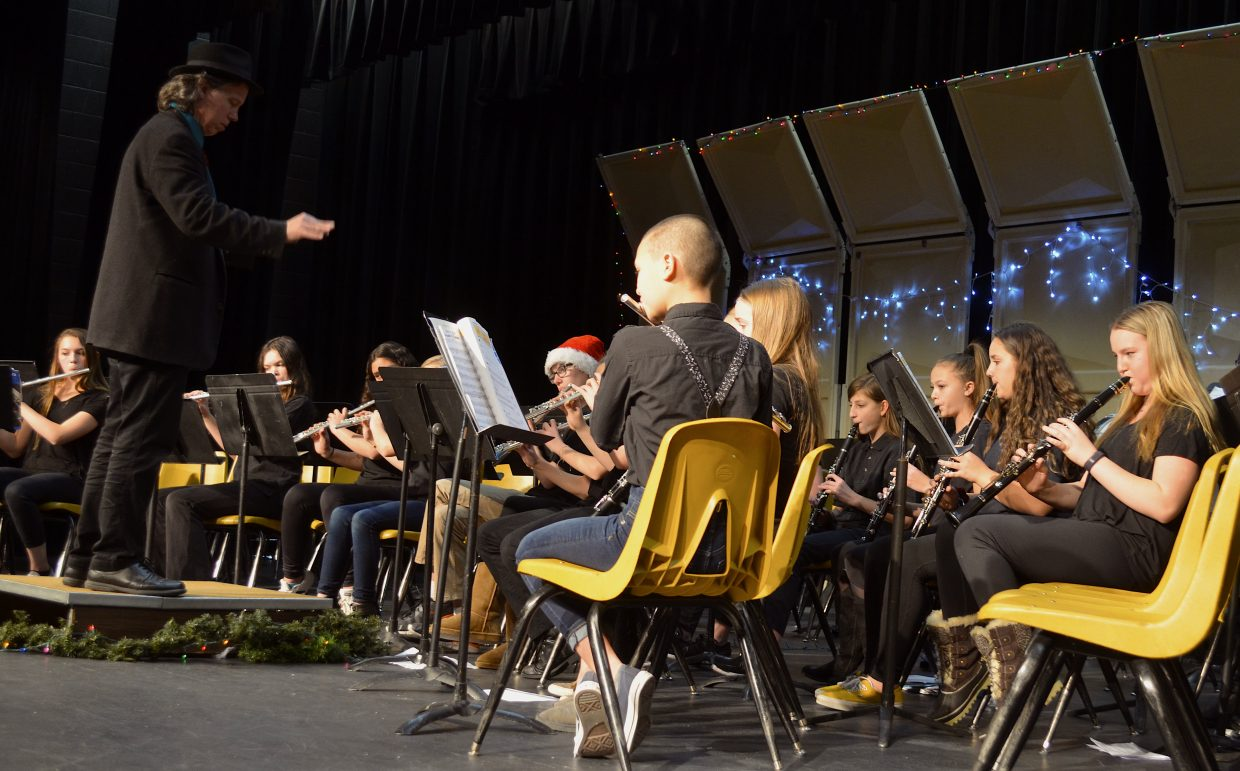 """Music Director Brad Pregeant guides seventh and eighth grade band members through a rendition of """"We Three Kings"""" Wednesday night in Granby."""