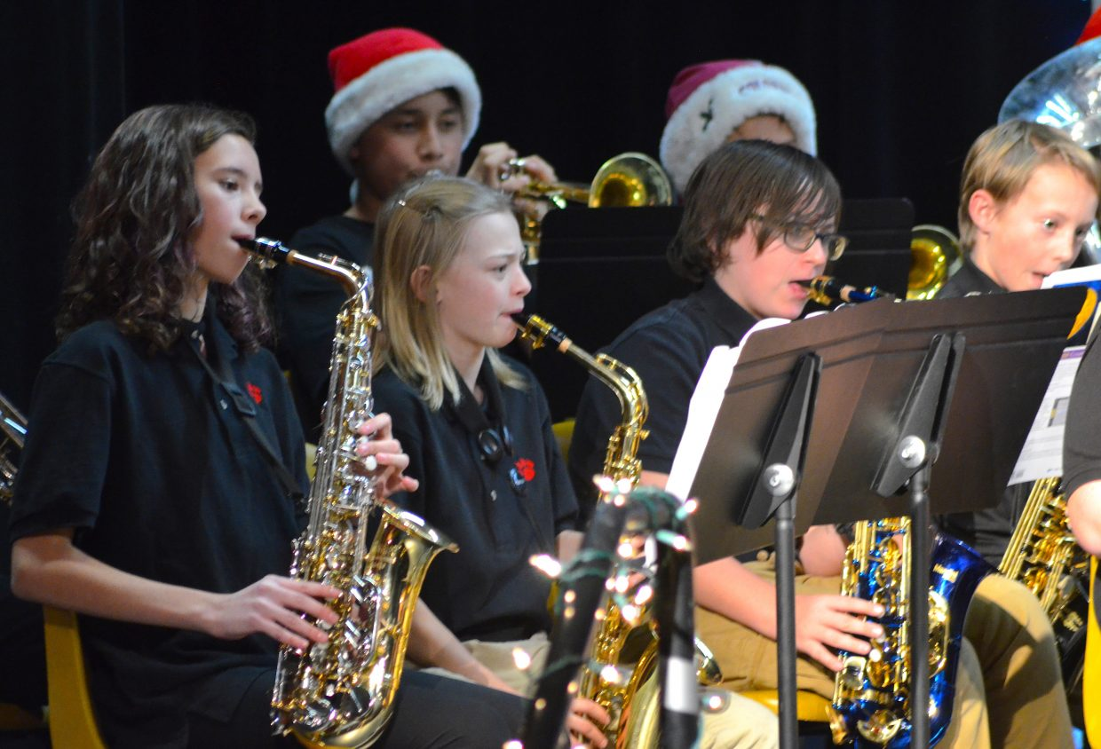 Junior high saxophonists focus on their music while performing for East Grand School District's annual Christmas band concert.