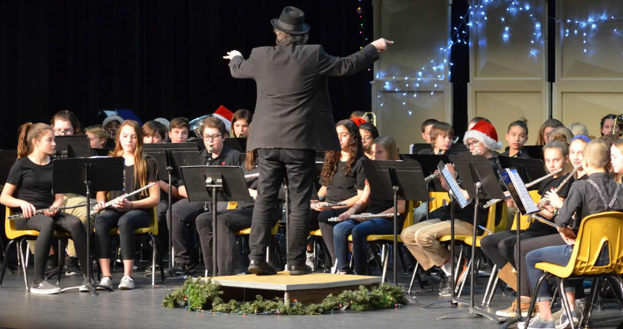 East Grand Music Director Brad Pregeant leads the seventh and eighth grade band during one of their songs at Wednesday night's concert.