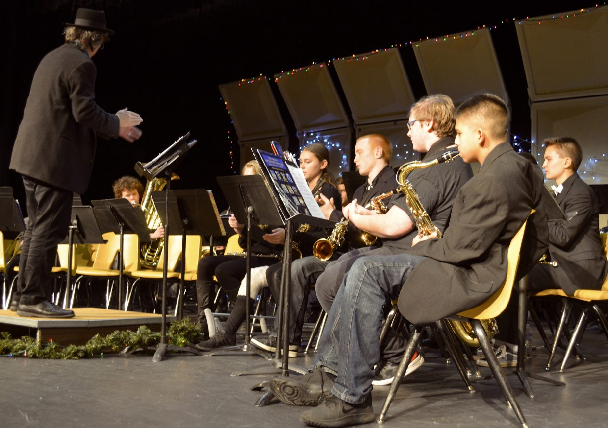 """High school band students play """"Go tell it on the mountain"""" during Wednesday night's Holiday Band Concert."""