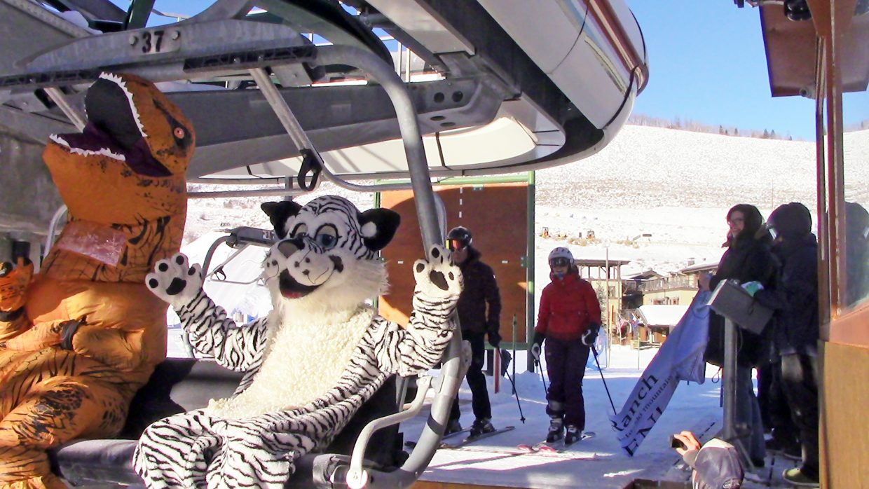 G-Rex and Ski Granby Ranch mascot Snowball head up the east mountain Friday morning on opening day.