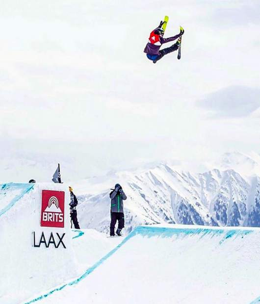 Sam Ward flies through the air in Laax Switzerland while competing with the British National Ski and Snowboard Team.