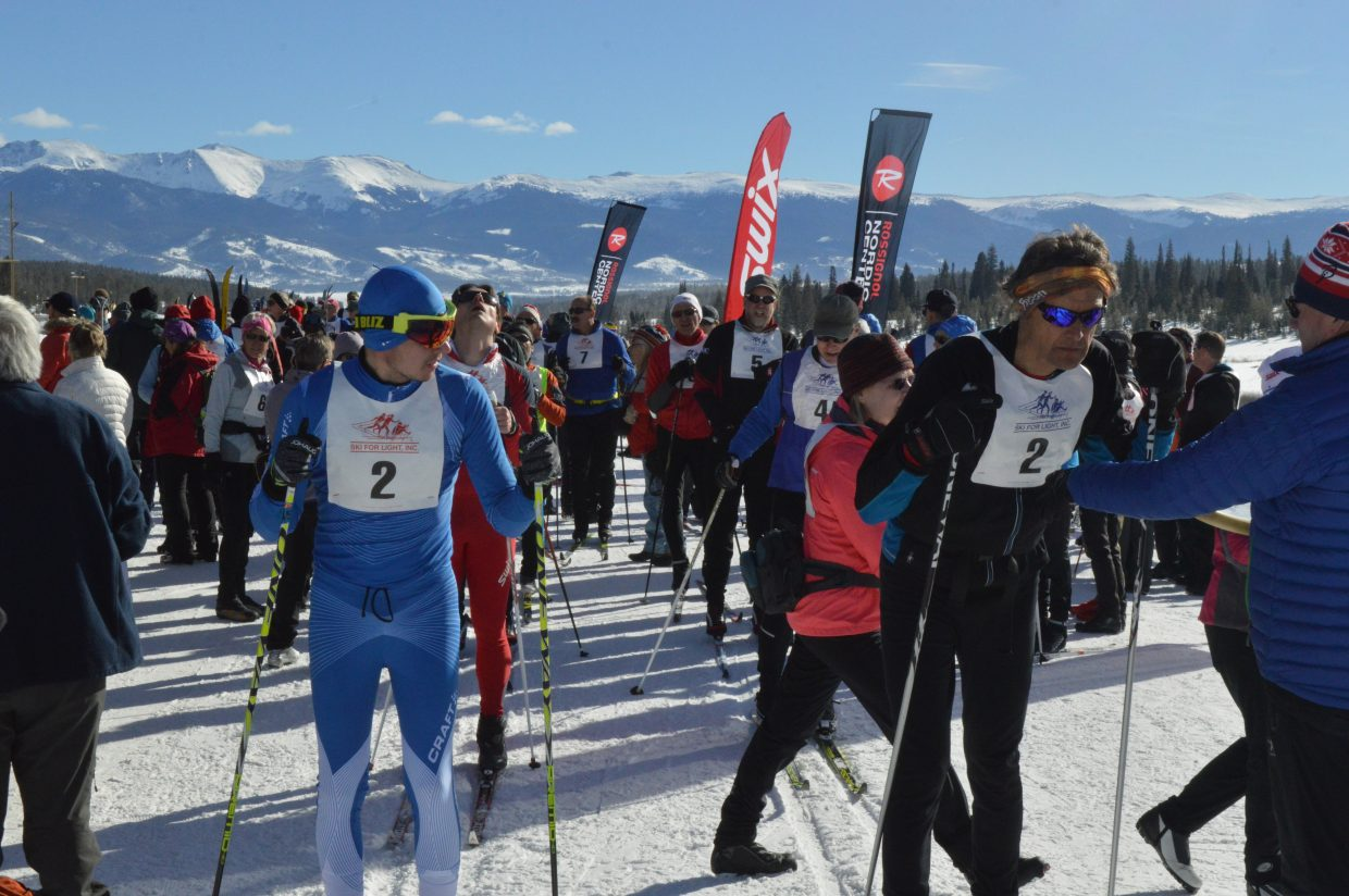 The first skier and guide pair prepare to kick off the 10 kilometer race. The skiers estimated how quickly they felt they could do the 10 kilometer race and were arranged from fastest to slowest with 15 second interval starts.
