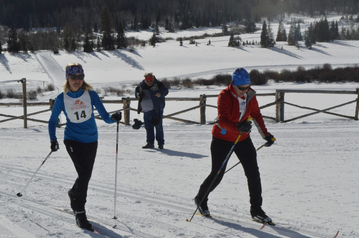 A skier and guide race on Saturday morning.