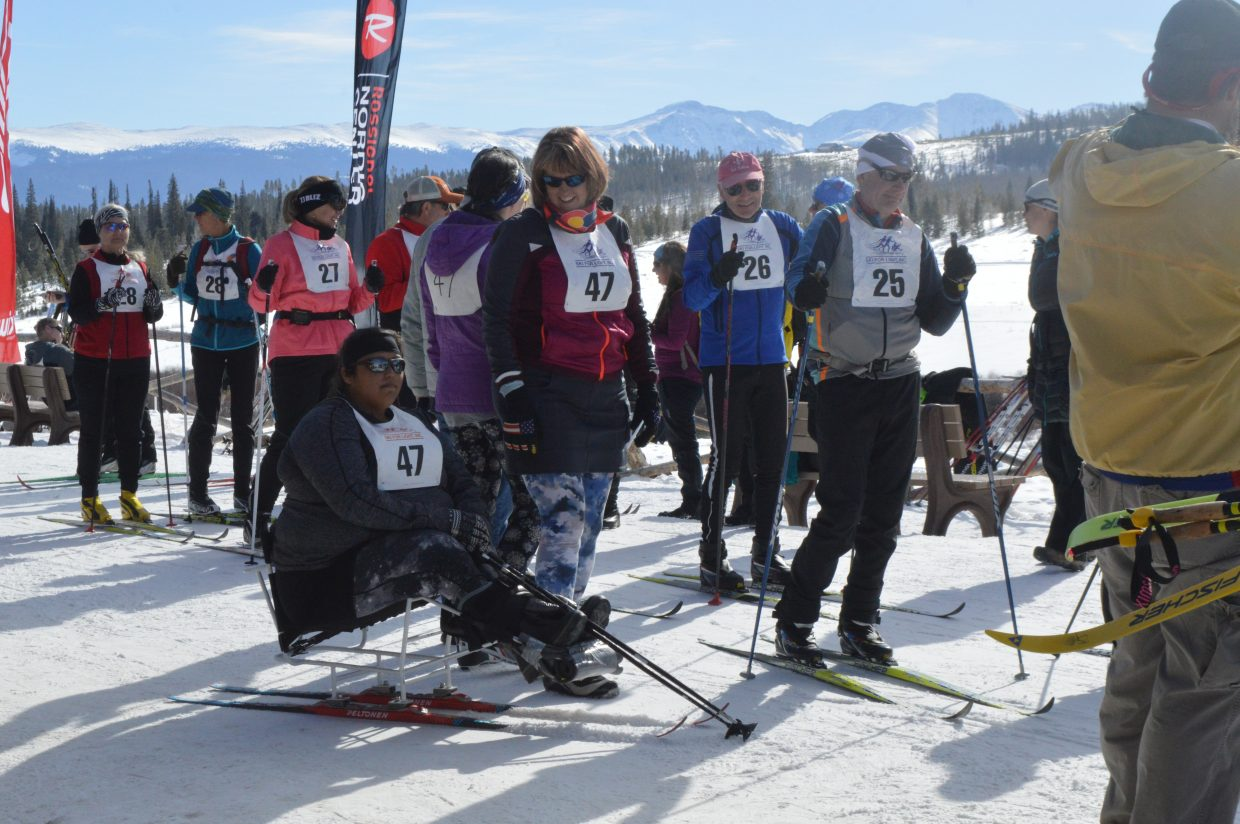 Skiers and guides wait in line to start the 10 kilometer race.