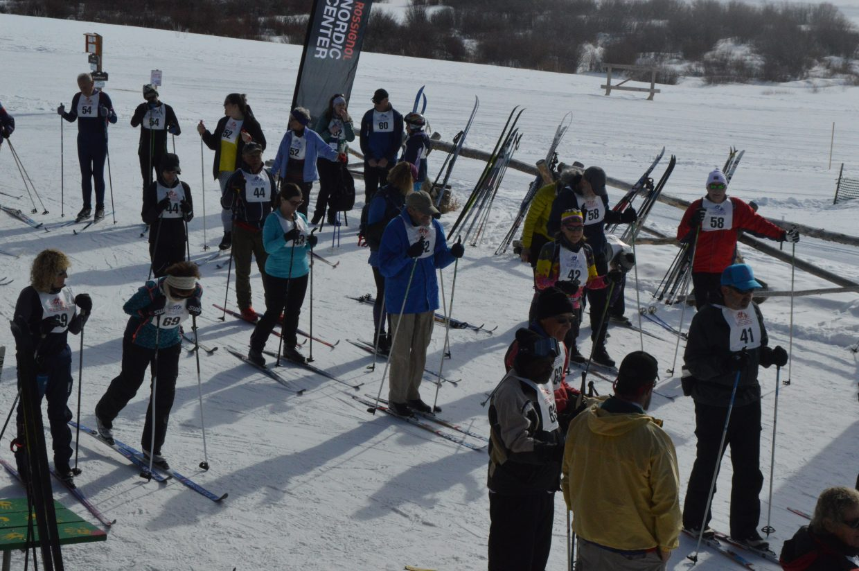 Skiers wait in line to get to the starting line for the 10 kilometer race Saturday morning.