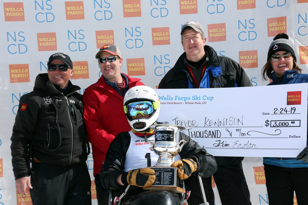 From left to right: (back row) Erik Petersen, NSCD Competition Director; Jim Johnson, Wells Fargo; Daniel Barry, Wells Fargo; Kim Easton, NSCD CEO (front row) Trevor Kennison, winner of the Whiting Petroleum World Disabled Invitational.