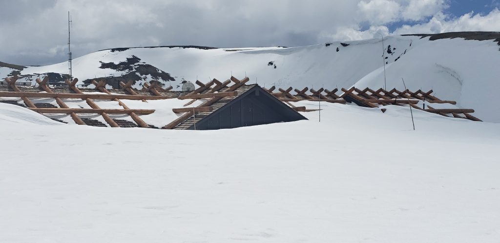 Plowing at 11,796 feet: Crews reach a buried Alpine Visitor