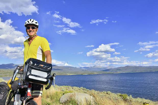 Mike Darrah poses for a photo in front of Lake Granby after completing a 3,400-mile bike ride from Fairbanks, Alaska, to Granby. The trip completed a string of long-distance bicycle trips stretching from the Artic Ocean to the U.S.-Mexico border.
