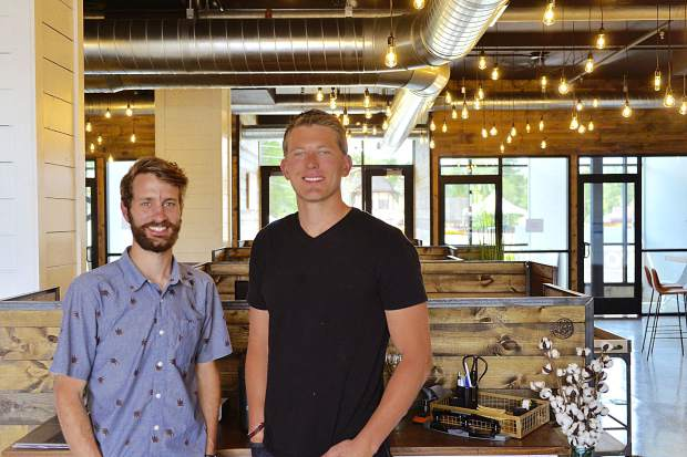 Jayson Harris, left, and Austin Gray recently opened Green Spaces, a new co-working space in downtown Winter Park. The business has another location in Denver, and members get unlimited access to both locations.